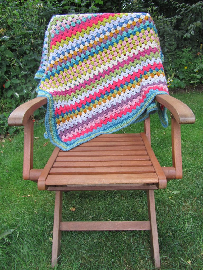 crochet blanket over chair