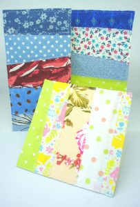 Three fabric greetings cards