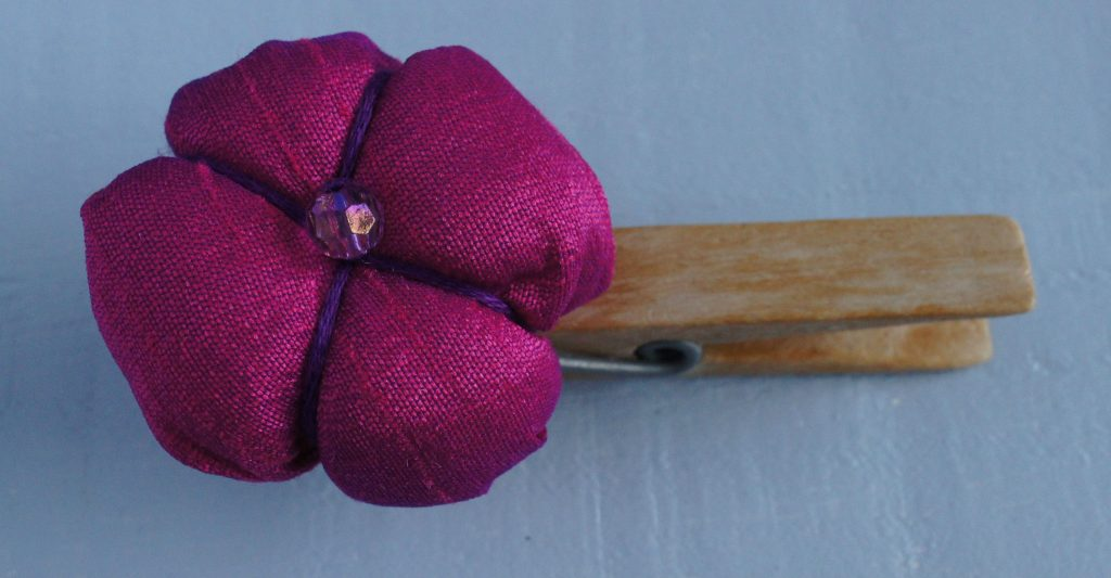 Silk ball flower on peg