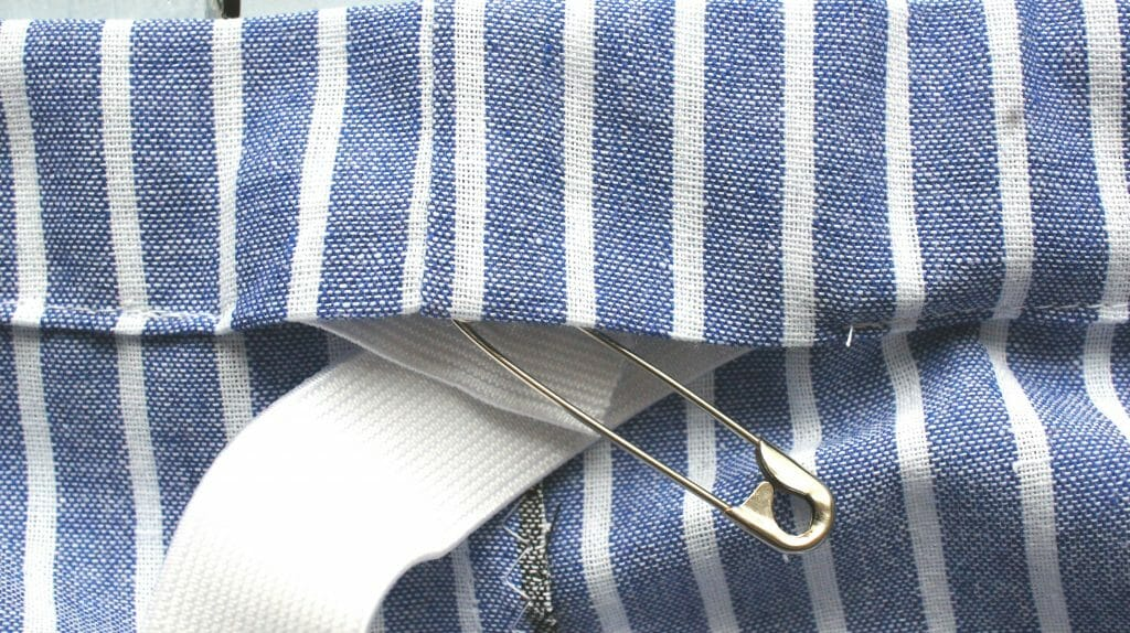 Elastic through hem