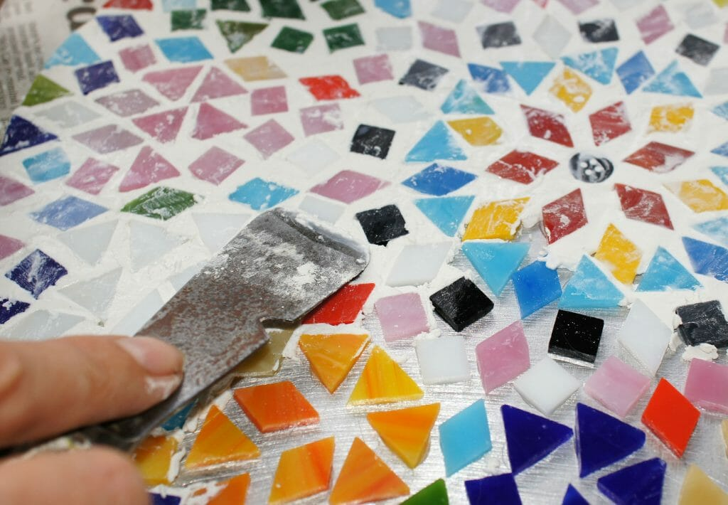Grouting the mosaic table