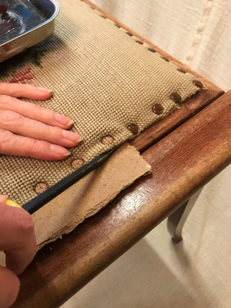 Removing upholstery pins