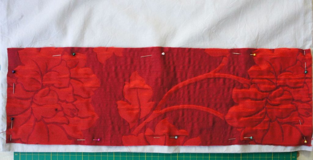 Applique piece pinned in place