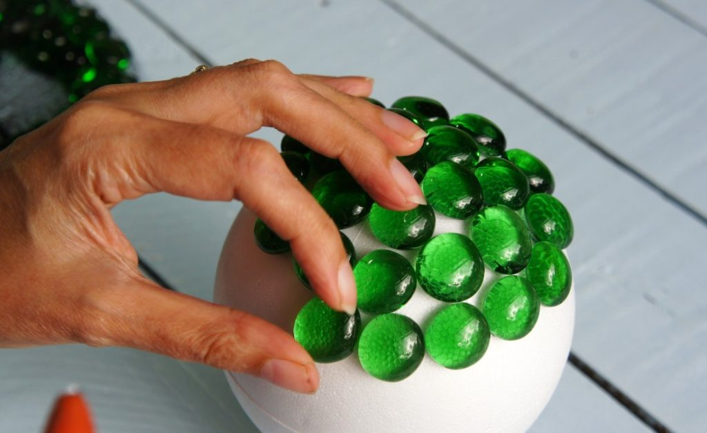 Applying beads to ball