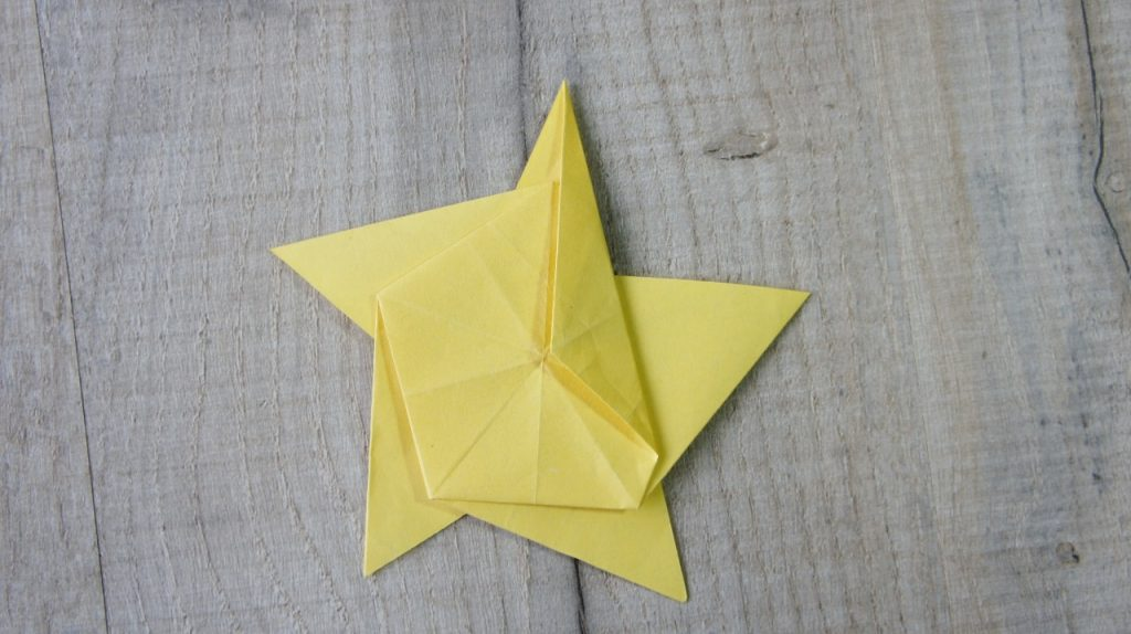 Fold onto front of star