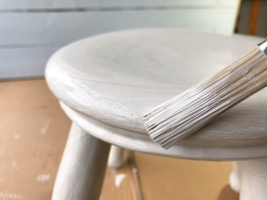 painting grey onto wooden stool top