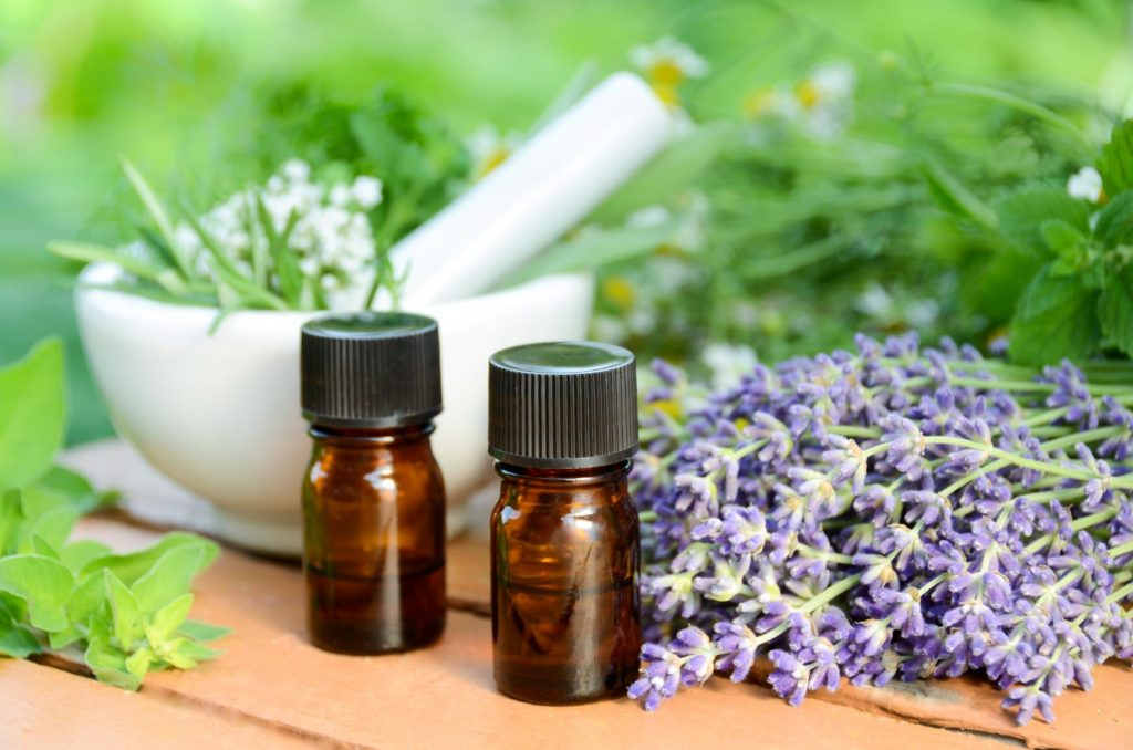 Lavender, Mortar and pestle and bottles for oil apothecary garden