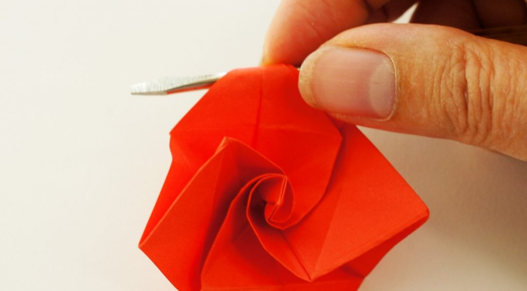 Curling the petals on the origami rose