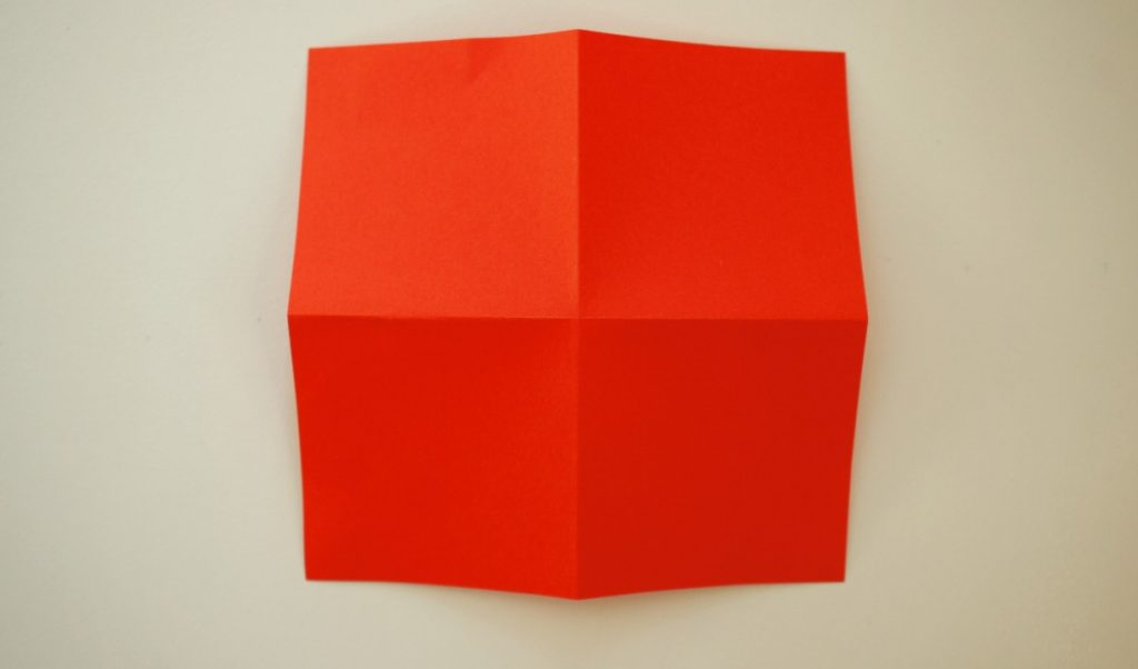 folded square of paper turned over