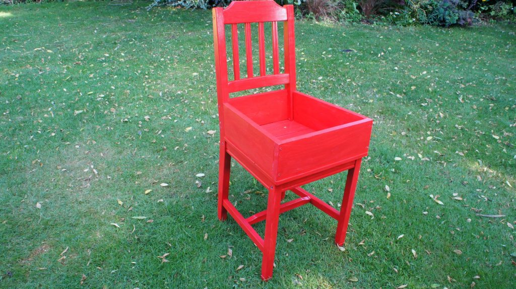 Chair painted red for succulent garden idea