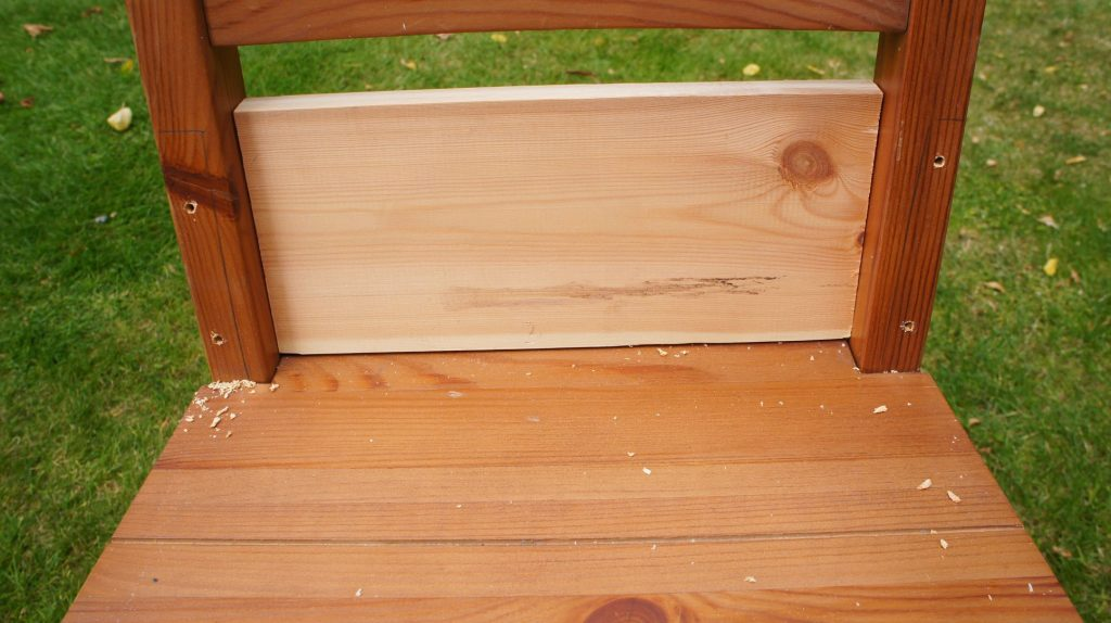 Drill holes in back for screws